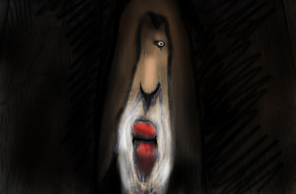 フードをかぶったたらこ唇の老人